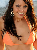 Kaydin in an orange bikini on the beach from Kissable Kaydin